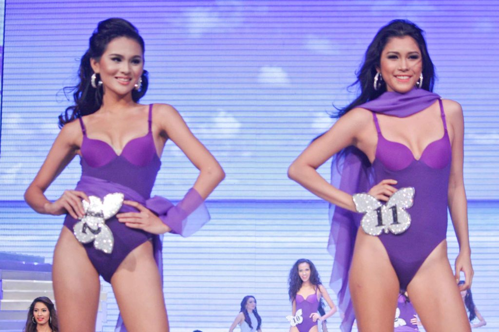 From left: #12 Zahara Soriano and #11 Jillean Orbina; candidates wore swimwear designed by Yvonne Quisumbing, Hajji Godinez for SALMALTO, Philip Tampus, Vania Romoff and OJ Hofer. Photo was taken during Miss Resort's World Final Runway competition at the New Port Performing Arts Theater Resort's World Manila last Nov 23, 2012. Photo by Jude Bautista