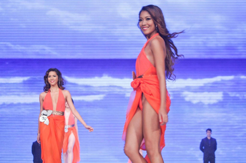 From left: #18 Angeli Gomez   #19 Phoebe Pataytay; candidates wore swimwear designed by Yvonne Quisumbing, Hajji Godinez for SALMALTO, Philip Tampus, Vania Romoff and OJ Hofer. Photo was taken during Miss Resort's World Final Runway competition at the New Port Performing Arts Theater Resort's World Manila last Nov 23, 2012. Photo by Jude Bautista