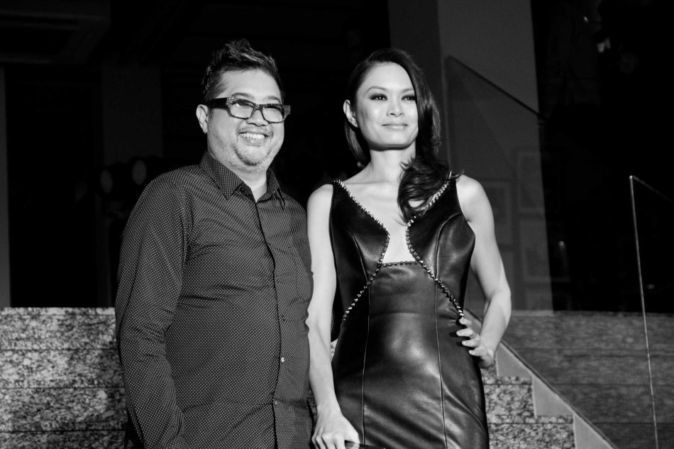 Apples Aberin wears a design by Rhett Eala (left) who created an original fashion ensemble inspired by FURNITALIA's leather furniture. The fashion show/ exhibit was during the FURNitalia Pelle Leather ball at the Bonifacio Global City showroom 30th cor Rizal Drive. Photo by Jude Bautista