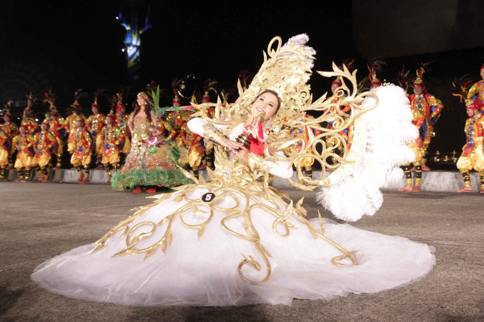 #5 Jamie Herrel of Cebu city (Sinulog Festival), also captured the imagination of the crowd by incorporating  the Sinulog's spinning movements during her walk. Catch the ALIWAN Fiesta from April 11-13, 2013 at the CCP Complex. Photo by Jude Bautista.