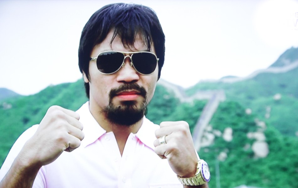 Congressman Manny Pacquiao poses at the Great wall of China. He was there to promote the Pacquiao vs Rios fight on November 24, 2013 (Manila Time)