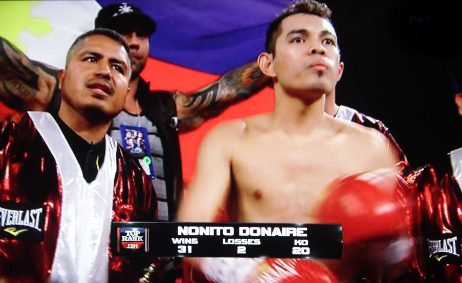Nonito Donaire Jr has the Philippine colors behind him. (right) coach Robert Garcia also trains Brandon Rios who has a fight w Manny Pacquiao November 24, 2013.
