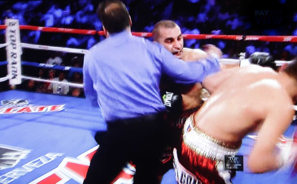 Ref Laurence Gole had to aggressively step in to stop Darchiniyan from punching in a wild exchange.