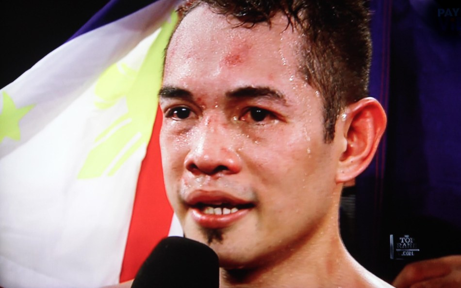 Nonito Donaire Jr has the Philippine colors behind him.
