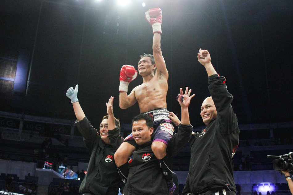 Donnie Nietes raises his hand in victory after 10th rd TKO victory over Gilberto Parra. He successfully defends his WBO/IBF World Jr Flyweight Belt for the 7th time. PINOY PRIDE 30 D-Day was held at the SMART Araneta Coliseum last March 28, 2015. Photo by Jude Bautista